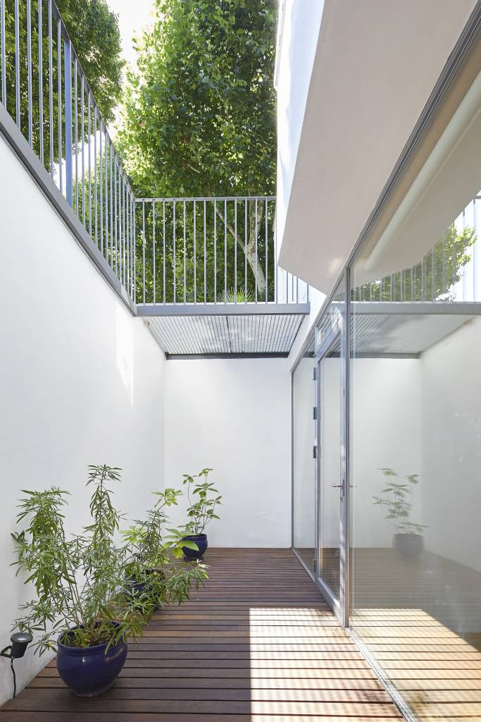 Hover House, a house in West London. The courtyard allows a fully glazed facade to the new lower floor